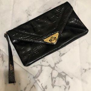 Black envelop wristlet, goldtone hardware